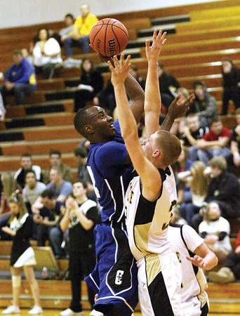 Charlestown senior Kendall Thomspon shoots over Henryville defender Brad Everage for two Tuesday night at henryville.  Staff photo by C.E. Branham