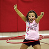 Wilson Elementary School third-grader Emily Reesor enjoys her success with a Hula-Hoop at the school's Family Fitness Walk and health Fair on Wednesday.  Staff photo by C.E. Branham