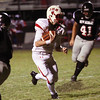 Jeffersonville junior quarterback Tyler Fridley keeps the ball for a two-yard touchdown against New Albany Friday night at Buerk Field.  Staff photo by C.E. Branham