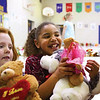 Maple Elementary School second-grader Gabrielle Ray clutches the two stuffed animals she received Friday morning at the school's 10th annual Bears on Parade program.  The event is hosted by the school to ensure every student receives a Christmas gift or has the opportunity to give a gift.  Staff photo by C.E. Branham