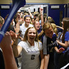 Members of the Providence High School soccer and volleyball teams are greeted by students at the beginning of a pep rally Friday afternoon.  The soccer team plays for the 1A state championship today in Indianapolis and the volleyball team competes for a 2A semi-state crown at Forest Park. Staff photo by C.E. Branham