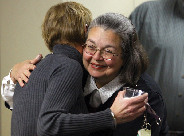 Sharon Beal, above, receives a hug at her reitrement gathering Thursday at the  Purdue University Cooperative Extension office in Charlestown.  For the past 36 years, Sharon has served as the Clark County Extension 4-H Secretary.  Staff photo by C.E. Branham