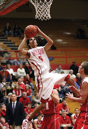 Jeffersonville senior Bryce Roland finishes off an alley oop against Madison Saturday night.  Jeff beat the visiting Cubs 78-44.  Staff photo by C.E. Branham