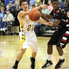 Floyd Central guard Quinton Miller whips a pass into the lane Friday night against New Albany.  Staff photo by C.E. Branham