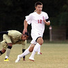 Jeffersonville midfielder Vincent Straight takes control of the ball as Corydon Central midfielder Antonio Chavez looks on in opening round play of the 2A sectional at Floyd Central.  Staff photo by C.E. Branham