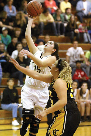 Henryville senior Sarah Richey scores two in a 46-23 win over Clarksville in the Henryville Tip-Off Tournament Friday night.  Staff photo by C.E. Branham