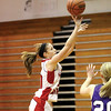Borden guard Abby Ellis finds finds room for a shot Thursday night against Lanesville at Borden.  Staff photo by C.E. Branham