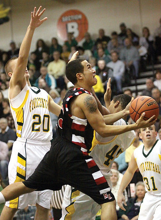 New Albany guard Jermain Parrish drives to the hoop in a 58-57 overtime win at Floyd Central Friday night.  Staff photo by C.E. Branham