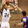 Henryville sophomore Andrew Jones puts up a three pointer against Silver Creek tuesday night.  Staff photo by C.E. Branham