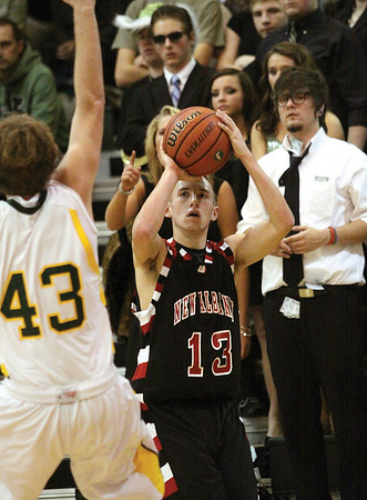 New Albany guard Garrett Arnold found space in the corner to bury a three at Floyd Central Friday night.  Staff photo by C.E. Branham