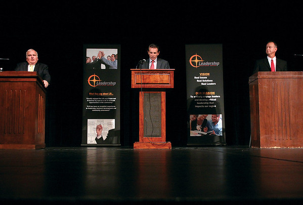 Jeffersonville mayoral candidates Democrat Tom Galligan, Libertarian Bob Isgrigg and Republican Mike Moore answer questions during a debate on Thursday night at Jeffersonville High School. The event, sponsored by The News and Tribune and Leadership Southern Indiana, was the second in a series of debates among mayoral candidates in Clark and Floyd counties. The final event will be in Charlestown on October, 4.<br /> Staff photo by C.E. Branham