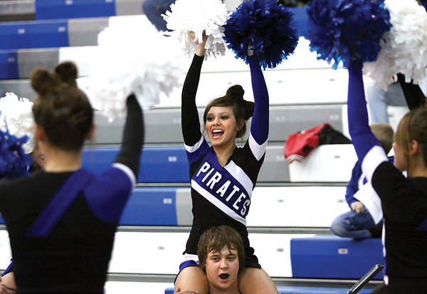 The Charlestown High School cheerleaders welcome the Pirates to the floor for their home opener against Scottsburg Friday night.  Staff photo by C.E. Branham