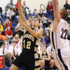 Henryville senior guard Evan Embry gets to the hoop for two Tuesday night in a 55-49 loss to Christian Academy of Indiana.  Staff photo by C.E. Branham
