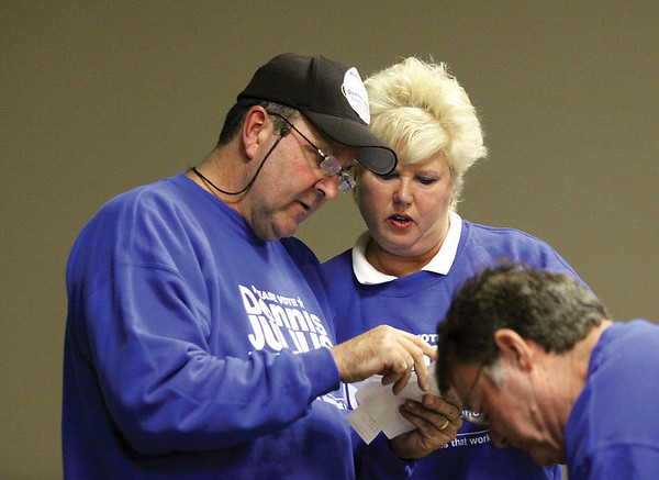 Democrat candidate for Jeffersonville City Council At-large Dennis Julius, looking over precinct totals with his wife Vickie Julius, won one of three seats.  Staff photo by C.E. Branham