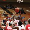 Jeffersonville senior Gary Kinnaird gets to the goal for two against Madison.  The Red Devils won the game 78-44.  Staff photo by C.E. Branham
