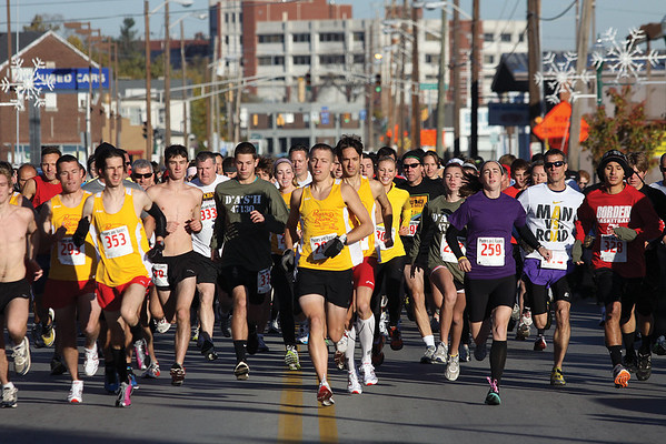 More than 100 participants head south on Spring St. Saturday morning in the  Jeffersonville Main Street Inc. 6th annual event, D*A*S*H 47130 5K and Veterans Day tribute.  Staff photo by C.E. Branham