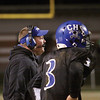 Charlestown coach Jason Hawkins and quarterback Aaron Daniel watch a measurement after the Pirates tried to convert on a fourth and one.  Charlestown turned the ball over to Corydon Central on downs.  Staff photo by C.E. Branham