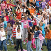 More than 500 students and staff combined at Parkwood Elementary School did jumping jacks for one minute Wednesday as participants in Let's Jump.  The nationwide event is an attempt by First Lady Michelle Obama to break the Guinness Book of World Records for most people doing jumping jacks in a 24-hour period.  Staff photo by C.E. Branham