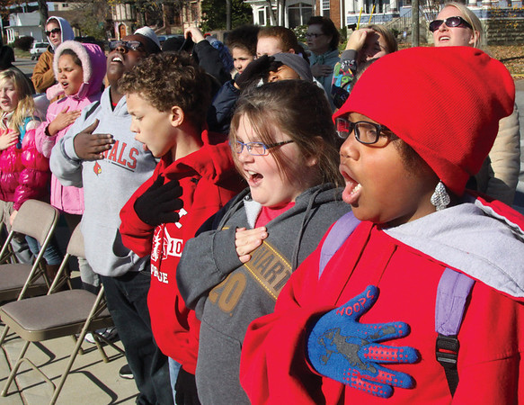Kairra James, and other students from Maple Elementary School, recite the pledge of allegiance at the start of a Veterans Day ceremony Friday morning at the Jeffersonville war memorial on Riverside Drive.  Staff photo by C.E. Branham