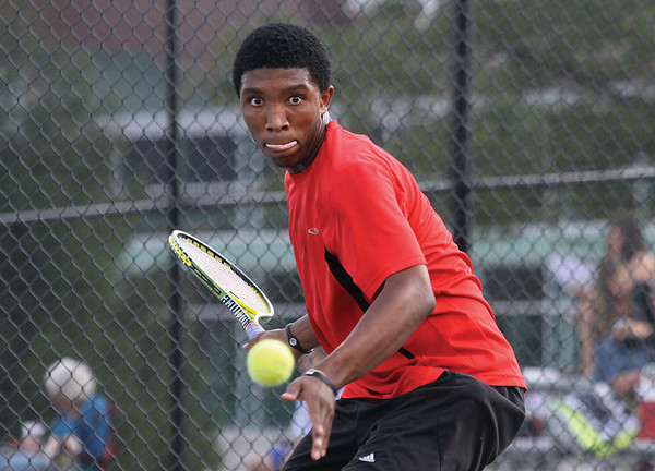 New Albany no. 1 singles player Kris Thomas eyes a return to Silver Creek player Jacob Loveland at New Albany on Monday.  Staff photo by C.E. Branham