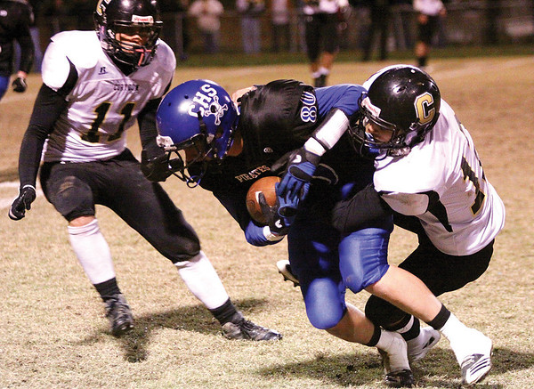 Charlestown wide receiver Wesley Sexton converts a first down on fourth and nine.  Staff photo by C.E. Branham