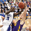 Charlestown senior Kendall Thompson is fouled under the basket by Scottsburg defender Alex Gullion.  Staff photo by C.E. branham