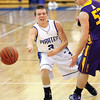 Charlestown senior guard David Cissell passes into the lane against Scottsburg Friday night.  Staff photo by C.E. Branham
