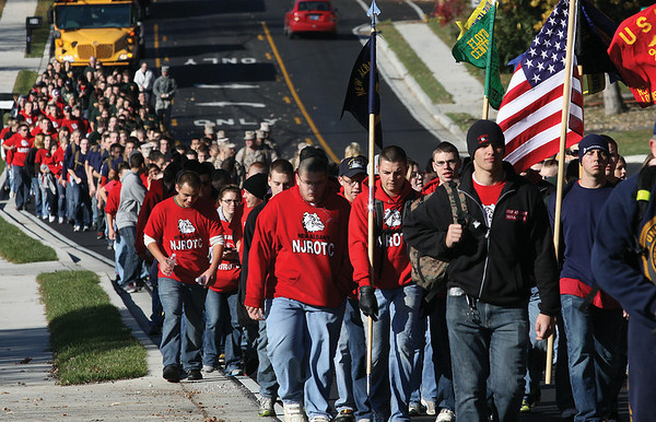 More than 300 members of the New Albany High School, Floyd Central High School and Washington High School Navy JROTC programs marched Saturday morning from Floyd Central High School to the New Albany National Cemetery.  Staff photo by C.E. Branham