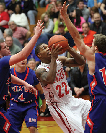 Jeffersonville guard Jordan Ellis split the Silver Creek defense for a basket in a 72-60 win Friday night at William S. Johnson Arena.  Staff photo by C.E. Branham