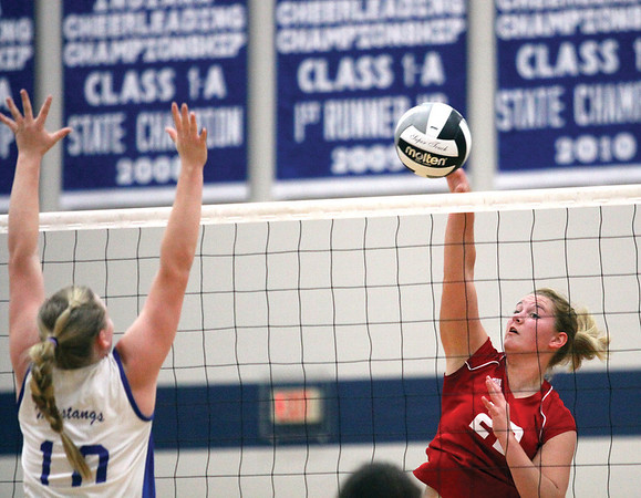 Borden outside hitter Erin Mikel delivers a kill to New Washington in opening round play of the 1A sectional.  Staff photo by C.E. Branham