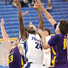 Charlestown guard Kendall Thompson battles Scottsburg players for a rebound Friday night.  Staff photo by C.E. Branham