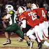 Floyd Central sophomore Nick Uhl picked up 35 yards with this carry for the Highlanders.  Staff photo by C.E. Branham