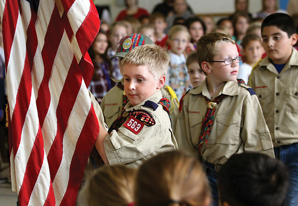 Dante Padgett and other Boy Scouts who attend Jonathan Jennings Elementary School present the flag at the school's Veterans Day program.  Staff photo by C.E. Branham