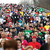 Runners head down Green Valley Rd. early Thanksgiving morning in the 23rd annual Fast Freddie's Festive Five Mile Foot Feast.  More than 1,000 runners registered for the event.  Staff photo by C.E. Branham