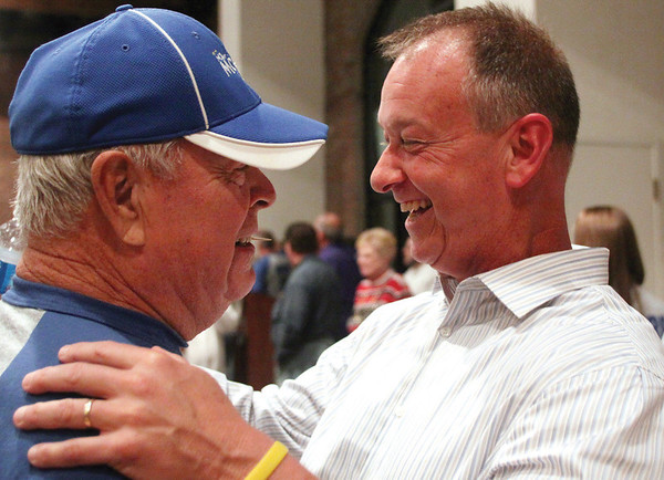 Republican Mike Moore celebrates with his father Charlie Moore after winning the Jeffersonville mayoral race.  Moore defeated Democrat incumbent Tom Galligan by 721 votes.  Staff photo by C.E. Branham