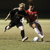 Jasper senior Ryan Huckelby and Jeffersonville defender Vincent Straight battle for possession in the 2A sectiona semi-final at Floyd Central.  Staff photo by C.E. Branham