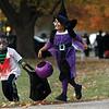 Jordan Sims, left, and Amia Bullitt run to collect another treat in Oak Park subdivision Halloween night.  Staff photo by C.E. Branham
