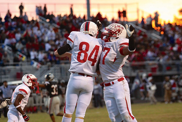 Jeffersonville players Dalton Atkins (84) and Derek Hughes celebrate a defensive stop against New Albany Friday night at Buerk Field.  Staff photo by C.E. Branham