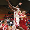 Jeffersonville senior Jordan Ellis scores against Madison in the first half Saturday night.  The Red Devils rolled over the visiting Cubs 78-44.  Staff photo by C.E. Branham