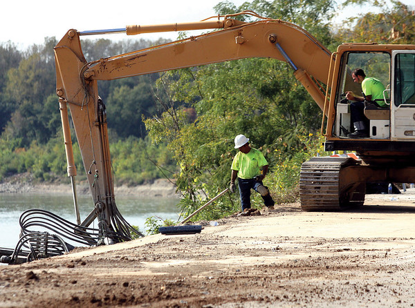 Workers are repairing a small collapsing section of Harrison Ave. near the George Rogers Clark Home Site and Boat Ramp.  Staff photo by C.E. Branham