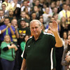 Coach Joe Hinton waves to the crowd at Floyd Central after the court was named in his honor Friday night.  Staff photo by C.E. Branham