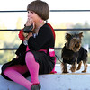 Leslie Moon, with her dog Oscar, talks with a friend while waiting for the Harvest Homecoming Dog Show to begin Monday evening.  Staff photo by C.E. Branham