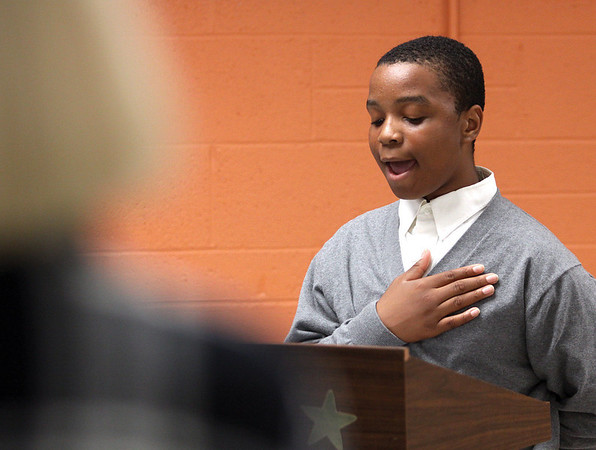 Corden Porter School student Kevon Nelson opened the school's dedication program Tuesday evening by singing the national anthem.  Staff photo by C.E. Branham