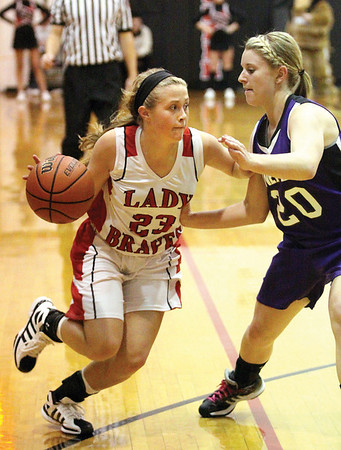 Borden sophomore guard Shelby Kirchgessner drives on Lanesville defender Brooklynn Keinsley Thursday night at Broden High School.  Staff photo by C.E. Branham