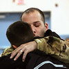 Shane Baker gives his son Austin Baker a hug and a kiss after surprising him with a visit to Thomas Jefferson Elementary School on Monday morning.  Staff photo by C.E. Branham