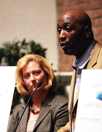 Former Greater Clark County board of trustees members Robbie Valentine, speaking, and Missi DeArk organized the event in support of superintendent Stephen Daeschner.  Staff photo by C.E. Branham