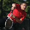 New Albany no. 2 singles player Luke Garmon serves to Silver Creek player Nick Quinkert at New Albany on Monday.  Staff photo by C.E. Branham