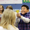 Wilson Elementary School second-grader Bryan Izquierdo rings a bell in a workshop at the school hosted by the Louisville Orchestra.  The workshops, for students in the school's Read 180 program, combine books, music, and fun and teach basic elements of music and pre-reading skills.  Staff photo by C.E. Branham