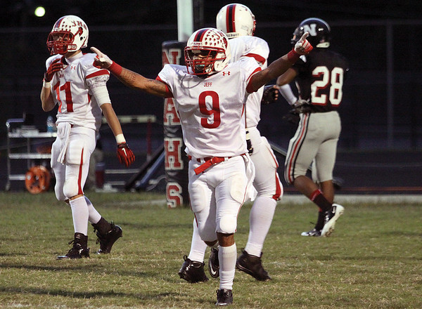 Jeffersonville senior Thomas Threat celebrates a 61-yard touchdown reception Friday night against New Albany.  Staff photo by C.E. Branham