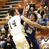 Charlestown junior Aaron Daniel is fouled by Henryville defender Dakota Harrell.  Staff photo by C.E. branham